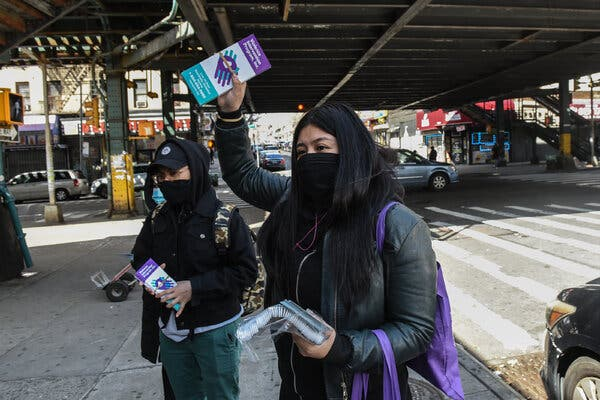 Handing out literature about domestic violence in the Bronx in April.