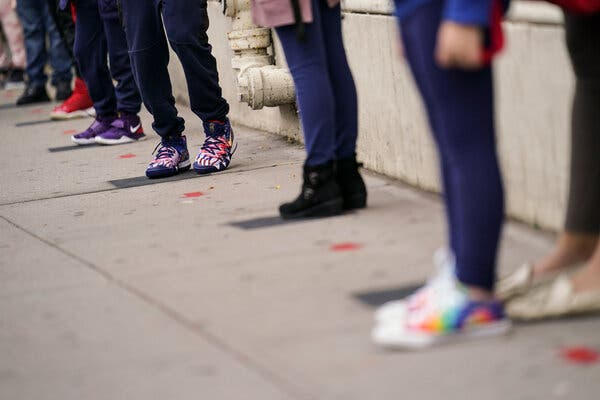 Students wait at distanced intervals as they arrive for school in New York in September. For teenagers in a mental health crisis, there aren't many places to turn.