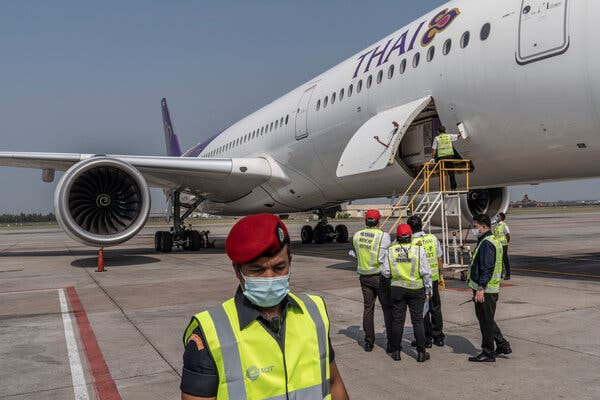 Preparing to offload a refrigerated container carrying Thailand's first delivery of Covid-19 vaccines at Suvarnabhumi Airport in Bangkok on Wednesday.